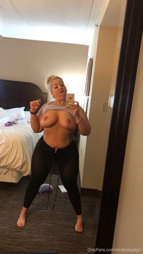 Big Ass Blonde with Huge Boobs in Spandex Leggings